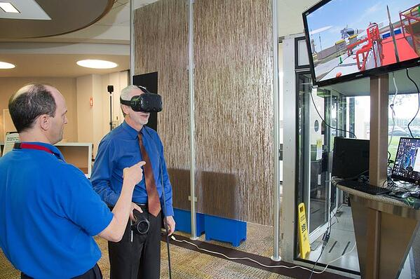Image Above: Chapter President James (Jake)Mireles sharing design in VR with participant.Provided by the NASA-JSC Imagery Online Database, NASA Photographer: Bill Stafford.